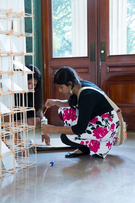 "Architecture program students Zoe Toledo of Logan, UT and Esrat Bristee of Boston, MA put finishing touches on their model phone booth, called ""Modern Cubism."" In their project description, they wrote that ""in essence [the] structure is providing people the opportunity to stop and take a moment to view the world in a different way."""