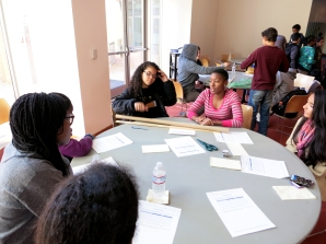 Mentor Kristen Ford facilitates a planning discussion with members of her team (clockwise from right): mentee Rojry Basnet, mentor and MITES '12 alum Elizabeth Rider, mentor Kristia Wantchekon, and mentees Doralee Heurtelou and Victoria Andrews.