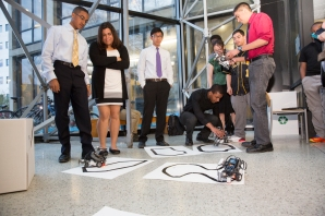Robots follow designated pathways as part of the junior class final presentation.