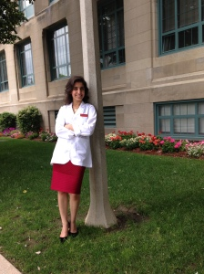 Roya in her lab coat on Boston University's campus. (Photo courtesy Roya Edalatpour)