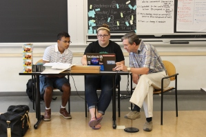 Physics instructors Tahmid Rahman, a STEM Program alum, and Hollie O'Brien review curriculum plans with veteran teacher Mike Craig. Tahmid and Hollie's level two students, who will enter seventh grade in the fall, also studied chemistry.