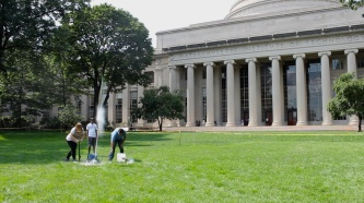 Instructors Holly O'Brien, Tahmid Rahman, and Matt Okabue launch their students' bottle rockets from Killian Court in front of MIT's iconic Great Dome.