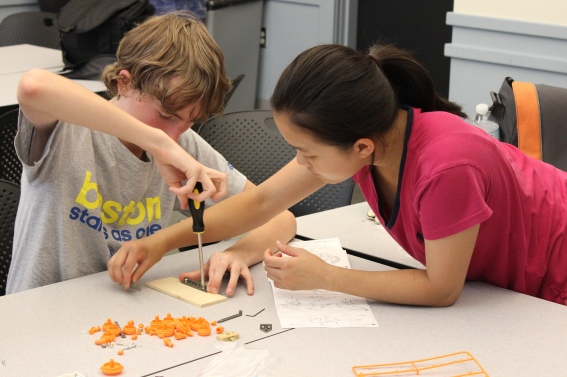 Level three engineering design students William Harney and Lucia Pan work together to build an electronic car.