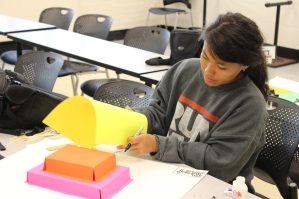 Level four student Erika Pun Builds a pre-calculus-based board game in preparation for the 2014 STEM Summer Institute Final Ceremony.