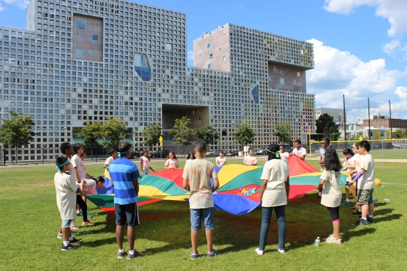 Students of all levels come together to play parachute games outside of Simmons Hall as part of field day on the last day of the 2014 STEM Program.