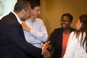 SanDisk Senior Vice President Gursharan Singh shakes hands with Kayla Tabb, a 2013 alum of E2@MIT and MIT freshman. SanDisk leadership traveled to the event from across the globe – Singh's manufacturing and supply chain operations role is based in India.