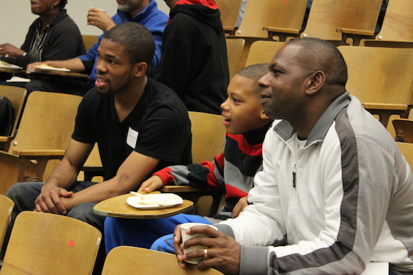 Mentor and mentee and dad attend the 2014 STEM Mentoring Program Orientation on October 18.