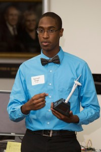 Student Samuel Zinga of Loganville, Georgia, uses a model to demonstrate how wind turbines generate energy.