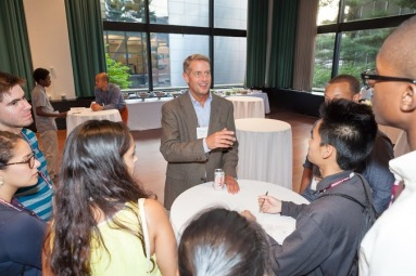 MOSTEC students practice their networking skills with EMBA student Dan Cosgrove at the professional mixer on July 31.